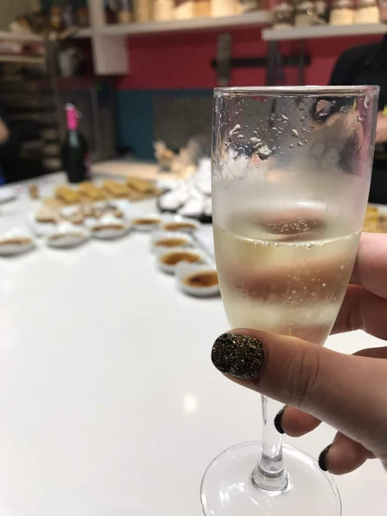Enjoying Champagne with our baked goods at Cook'n With Class Paris